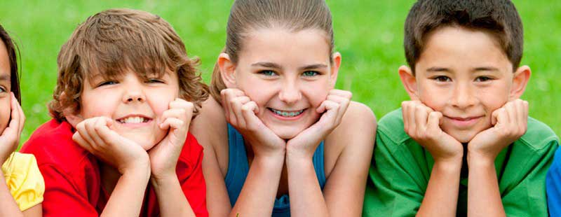 Three kids smiling